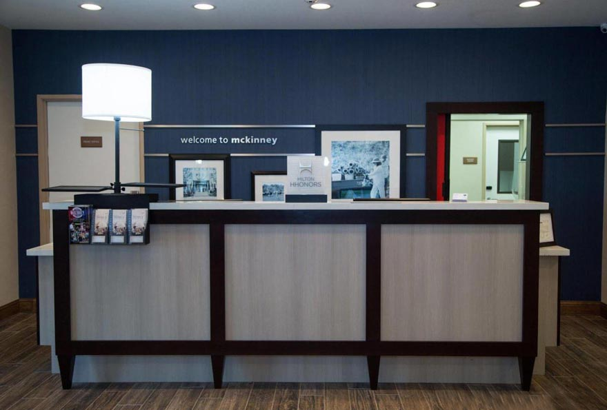 Commercial Real Estate Loan Closings Pioneer Realty Capital Hotel Hampton Inn McKinney Texas Front Desk
